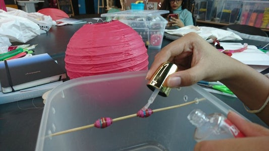 Paint the Beads With Transparent Nail Polish
