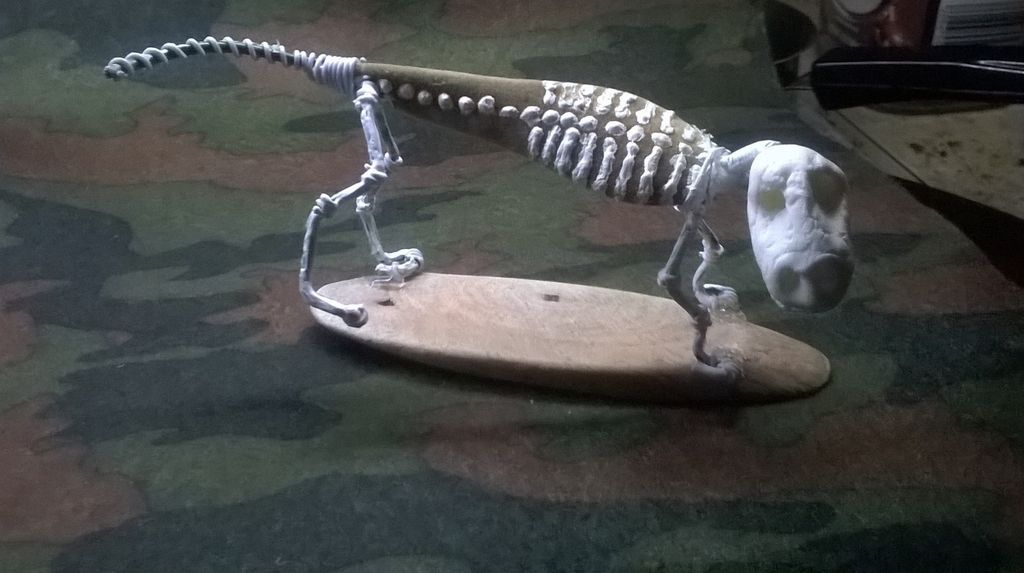 Picture of Mounting the Formed Legs, Head and Tail.