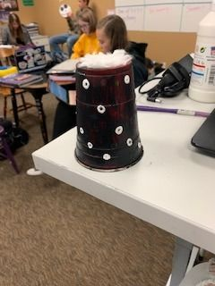 Picture of Step 3- Take Q-tip and Your White Paint. Dip the End of the Q-tip Into the White Paint and Start to Create Polka Dots Around Your Cup