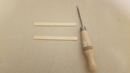 Punch a Hole in the Craft Sticks