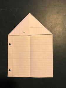 Unfold the Paper and Fold Each of the Top Corners Into the Center Line