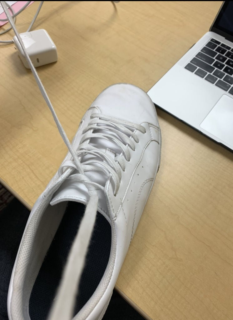 Picture of Pull Laces Together Until a Knot Is Formed at the Surface of the Shoe