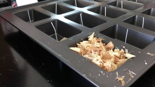 Packing the Wood Shavings Into the Mold