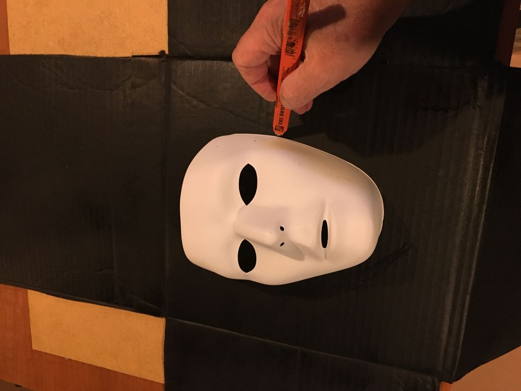 Picture of Trace the Mask and Cut Out a Hole in the Rear Face of the Box.