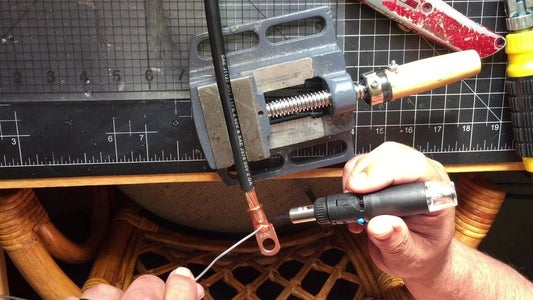 Take the 2 Gauge Wire and Cut the End for the Copper Lug Then Solder