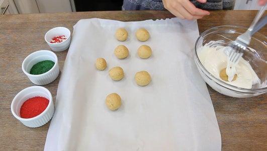 Dip Truffle Ball Into Chocolate