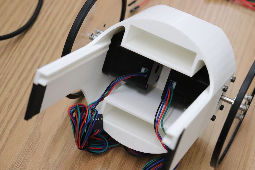 Picture of Add Motors, Wheels and Tape to the Casing