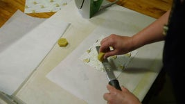 Start by Grating Beeswax Onto Fabric