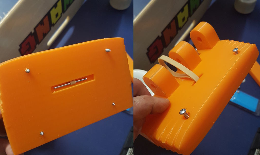 Picture of Add the Rubber Band and Attach Hinge Device to Skateboard