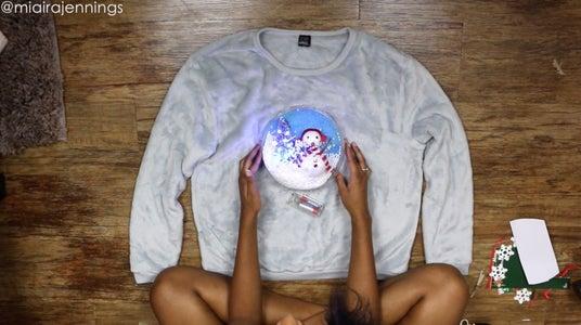 Add Globe to Sweater