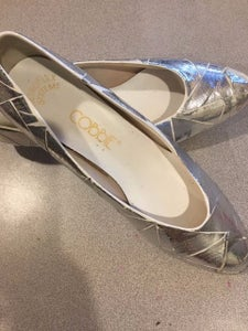 Using Silver Duct/duck Tape, Cut Out Random Sizes of Triangles, and Adhere to the Shoes As Shown