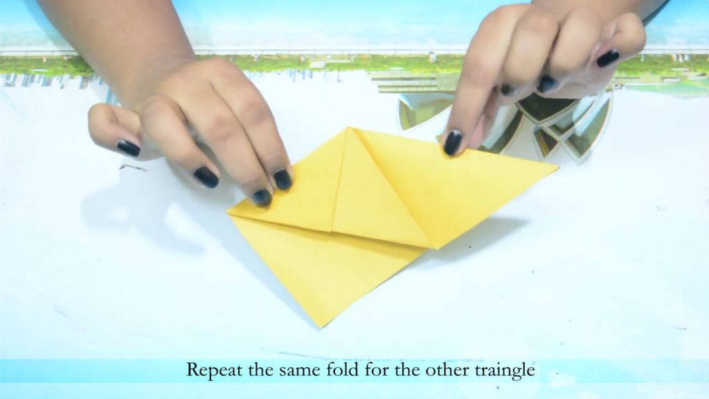 Picture of Take One Side of the Triangle and Fold in Inside the Previous Fold