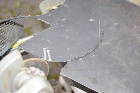 Cut Pie Shaped Sheet Metal Pieces With a Grinder.