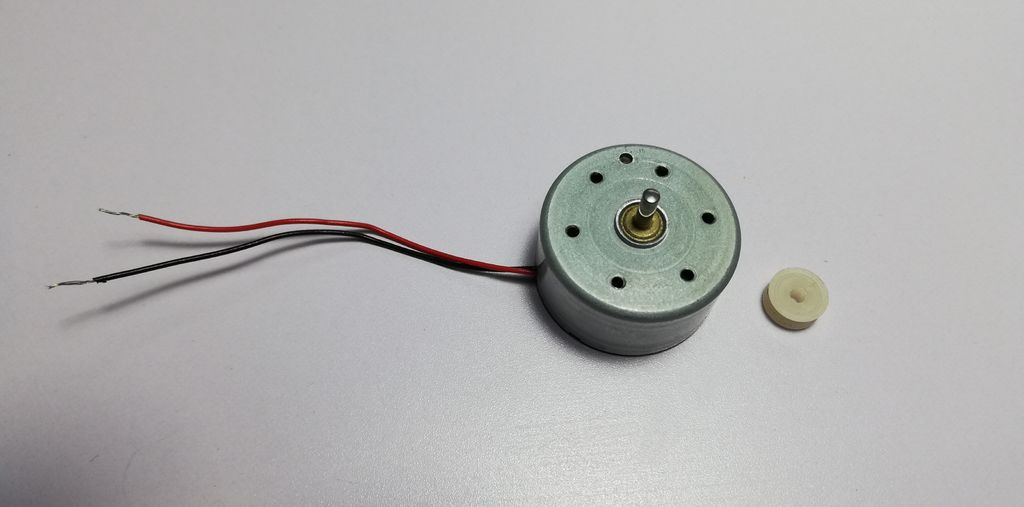 Picture of Glue a Piece of Velcro Strip to the Back of the Small DC Motor
