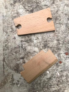 Cut Out the Bridge and the Tailpiece From Maple Wood, and Paint Them