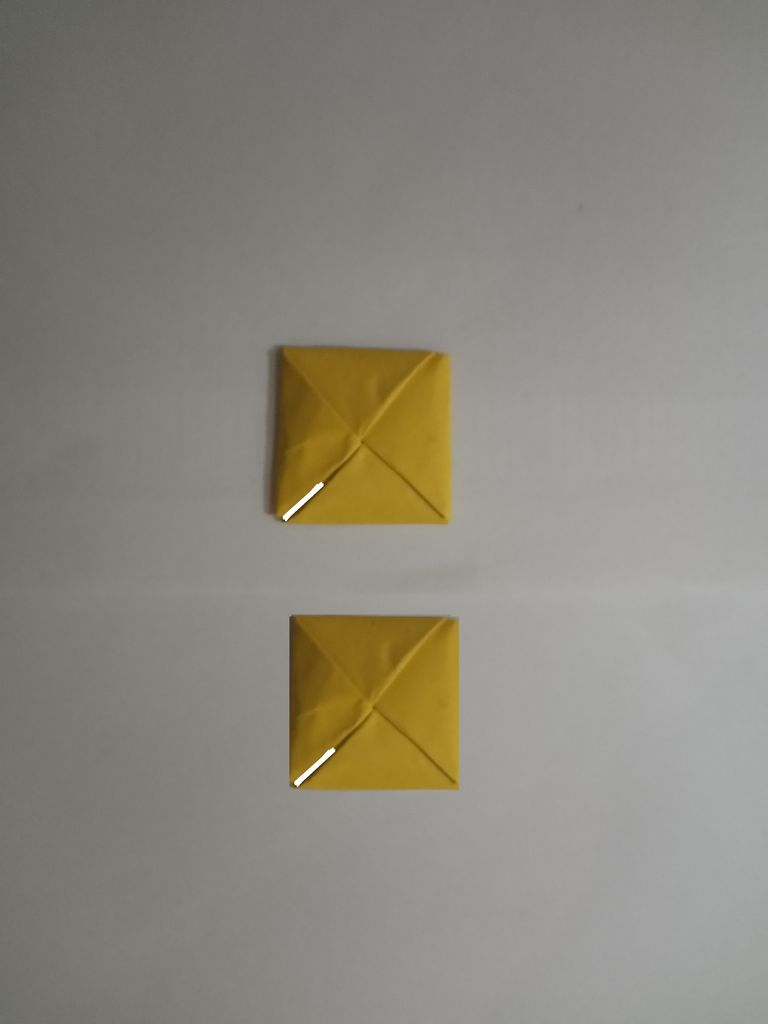 Picture of Make a Diagonal Cut a Quarter of the Way on Both the Pieces.