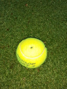 Make a Hole in the Tennis Balls