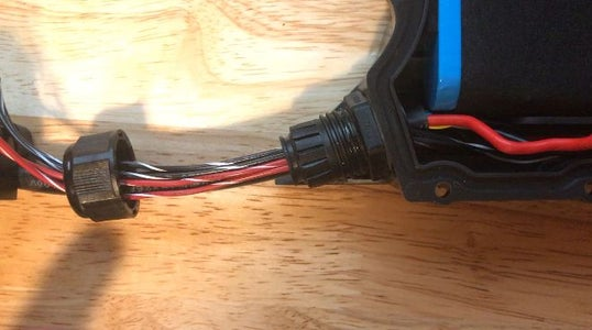 Thread the Wires Through the Grommet.