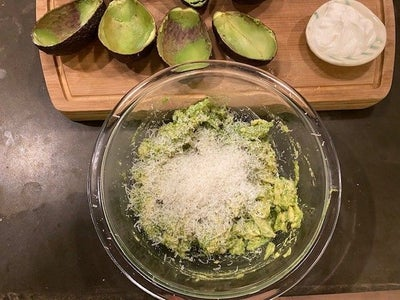 Grate 1/4 Cup of Parmesan Cheese and 1 Clove of Garlic Into the Avocado