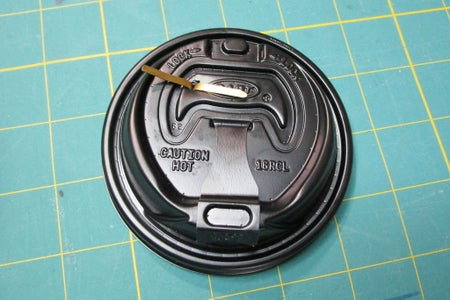 Attach Soda Tab to Underside of Lid.