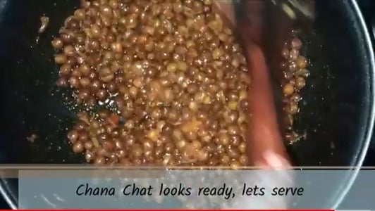 Adding Chickpeas in the Masala