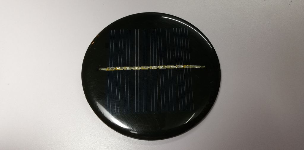 Picture of Solder the Cables of the Small DC Electric Motor to the Solar Panel
