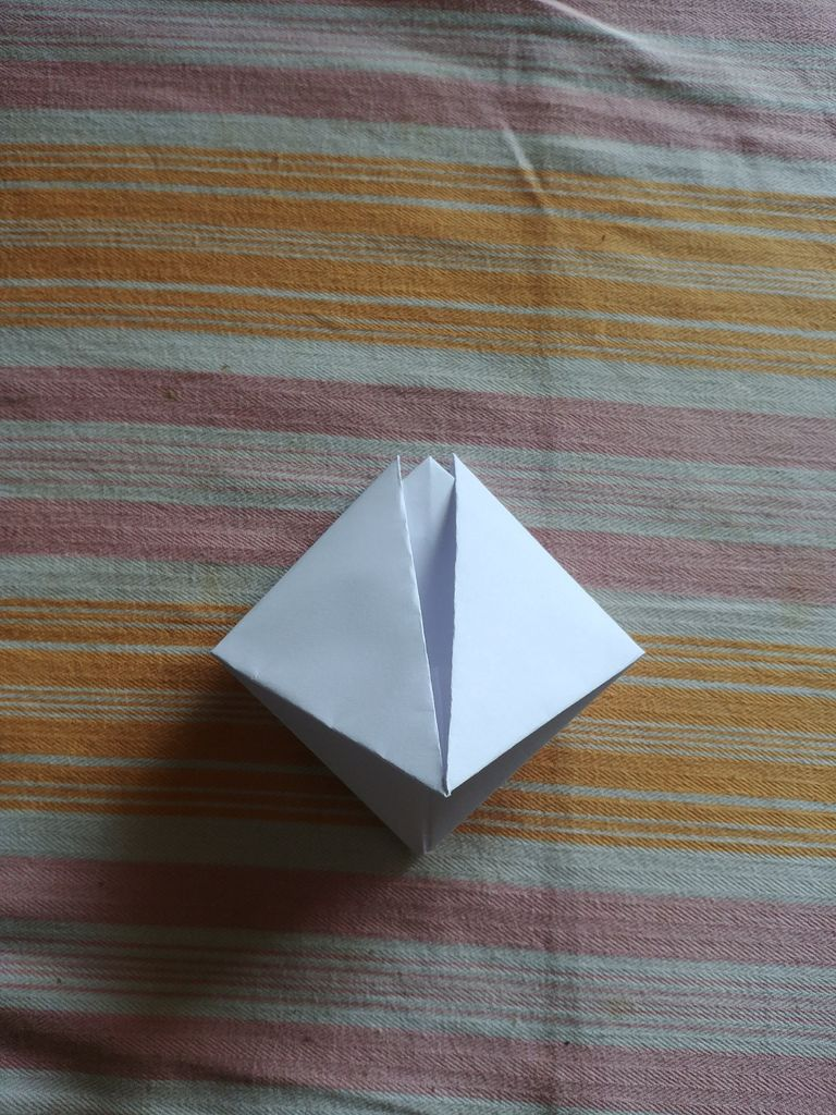 Picture of Pull the Top Edges Apart, and Flatten the Paper.