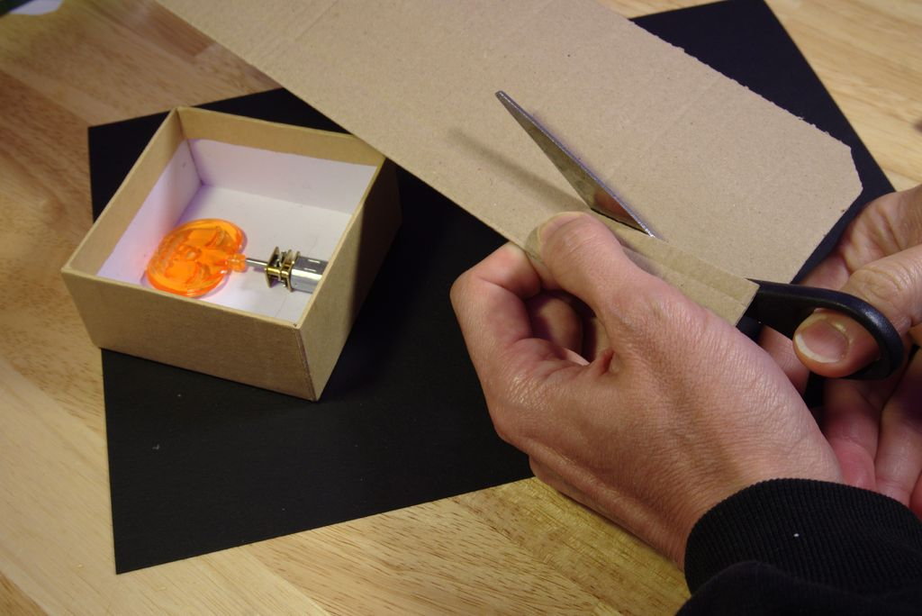 Picture of Mount the DC Motor in the Cardboard Box