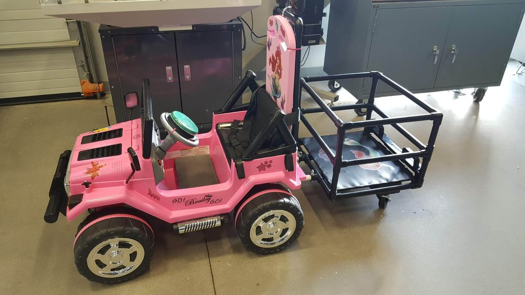 Picture of WSU GoBabyGo Build Modification - Trailer Attachment and Big Red Button Steering Wheel