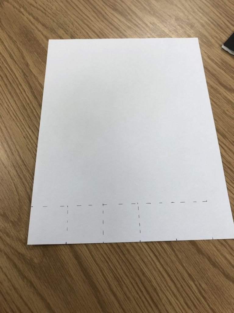 Picture of Measuring and Cutting White Squares