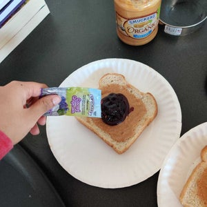 Squeeze Two Packets of Jelly Onto One Slice of Bread
