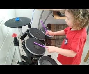 打开X-box游戏机摇滚乐队鼓入一个MIDI独立式电子鼓。