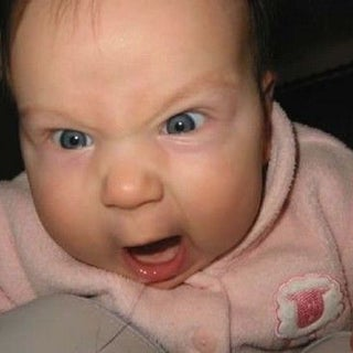 Baby makes a funny mad face.jpg