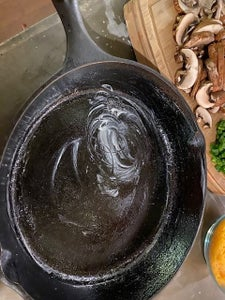 Add EVOO to the Cast Iron Skillet