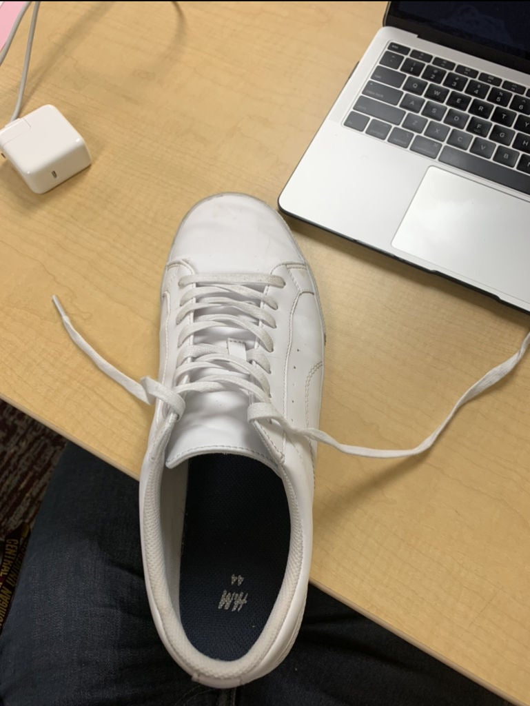 Picture of Grab Both Laces and Place Them on Either Side of the Shoe