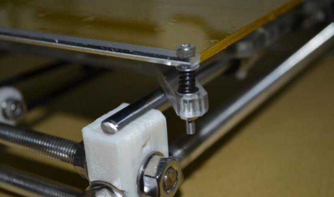 Picture of Apply a Thermistor to the Front of the Hot Bed and Fix the Hot Bed to the Y-axis