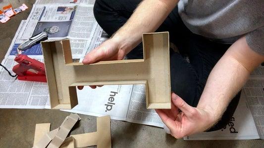把硬纸板字母变成混凝土模子