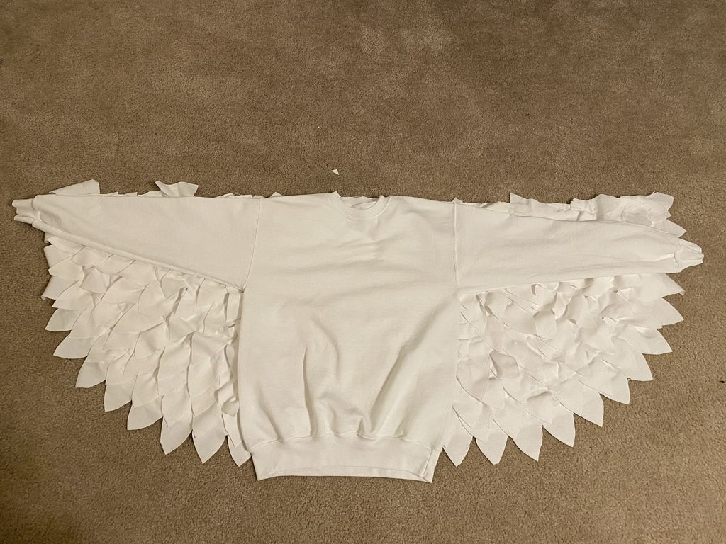 """Picture of Attach """"Wings"""" to Sweater"""