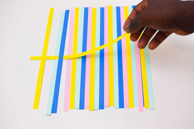 Picture of Pick a Yellow Strip (the First in the Order) and Insert Under and Above Each Vertical Strip