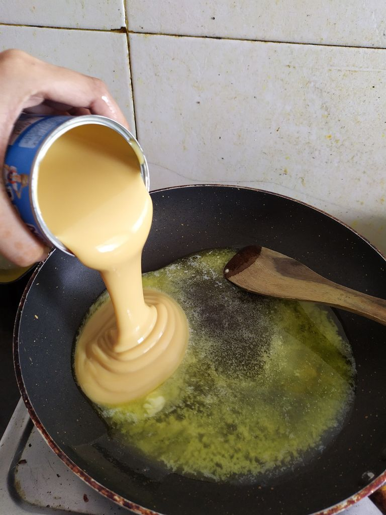 Picture of MELTING THE BUTTER AND CONDENSED MILK