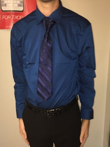 Lower Your Collar and Align Tie So That the Knot Is Centered.