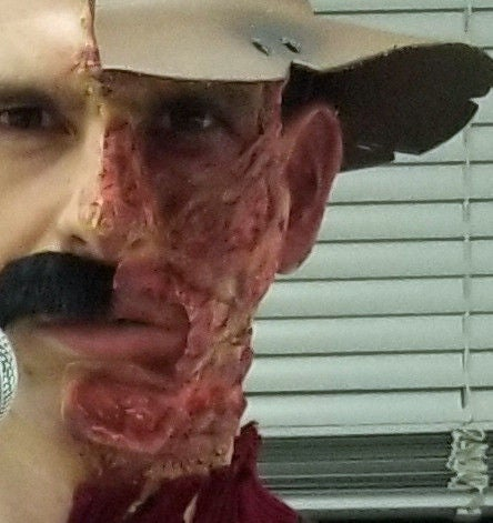 Picture of Applying the Krueger Makeup!