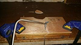 Put Holes in Cigar Box.