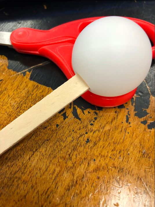 Picture of Put a Popsicle Stick Inside of the Ping Pong Ball.