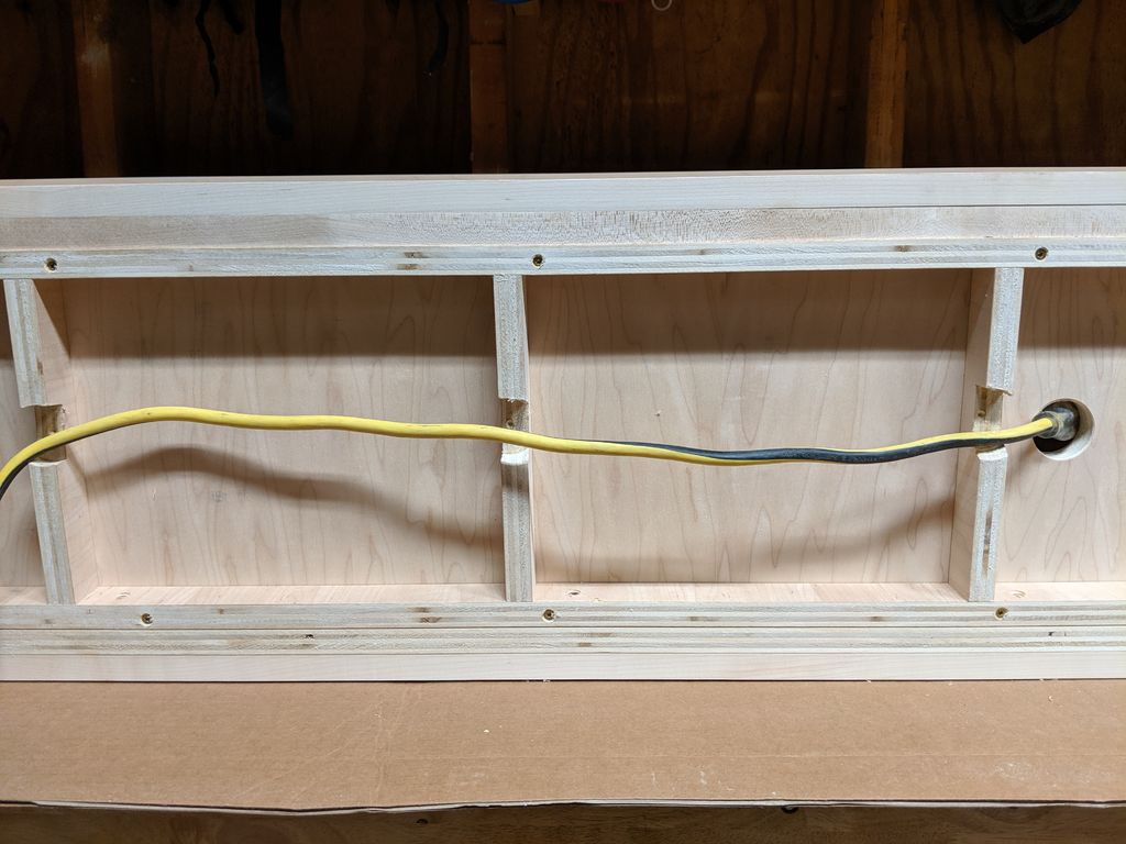 Picture of Power Can Be Run From Cord or Outlet Under Unit