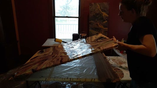 Tilt the Canvas to Move the Paint Around and Off of the Canvas.