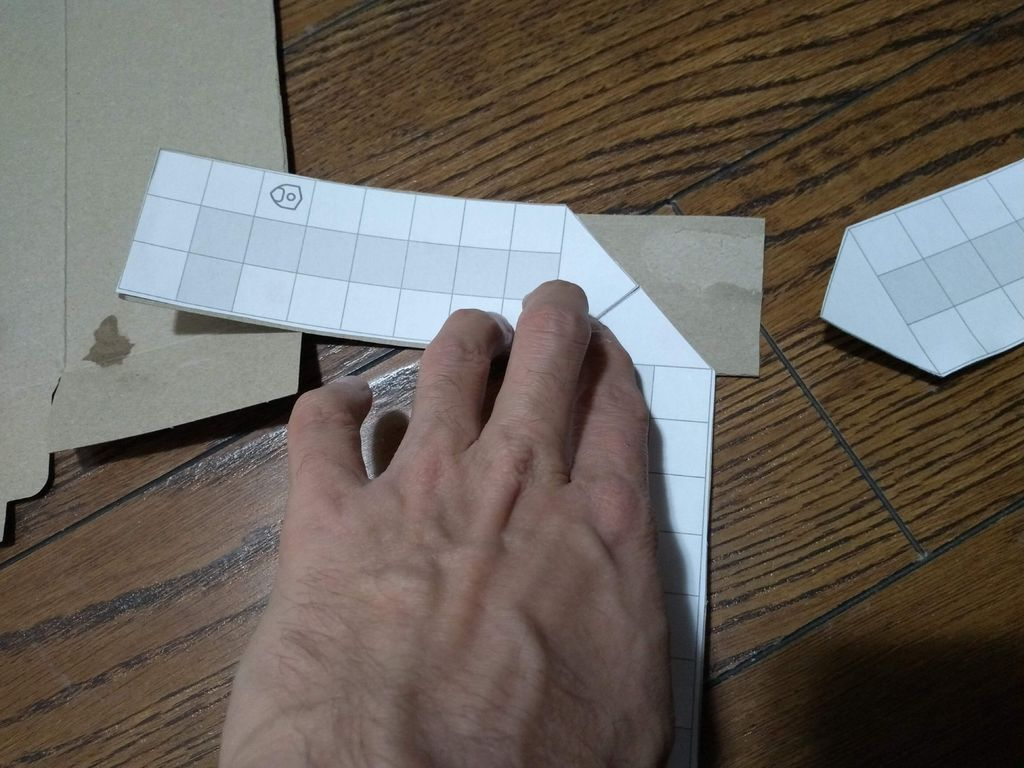 Picture of Paste All the Four Strips on Another Piece of Cardboard