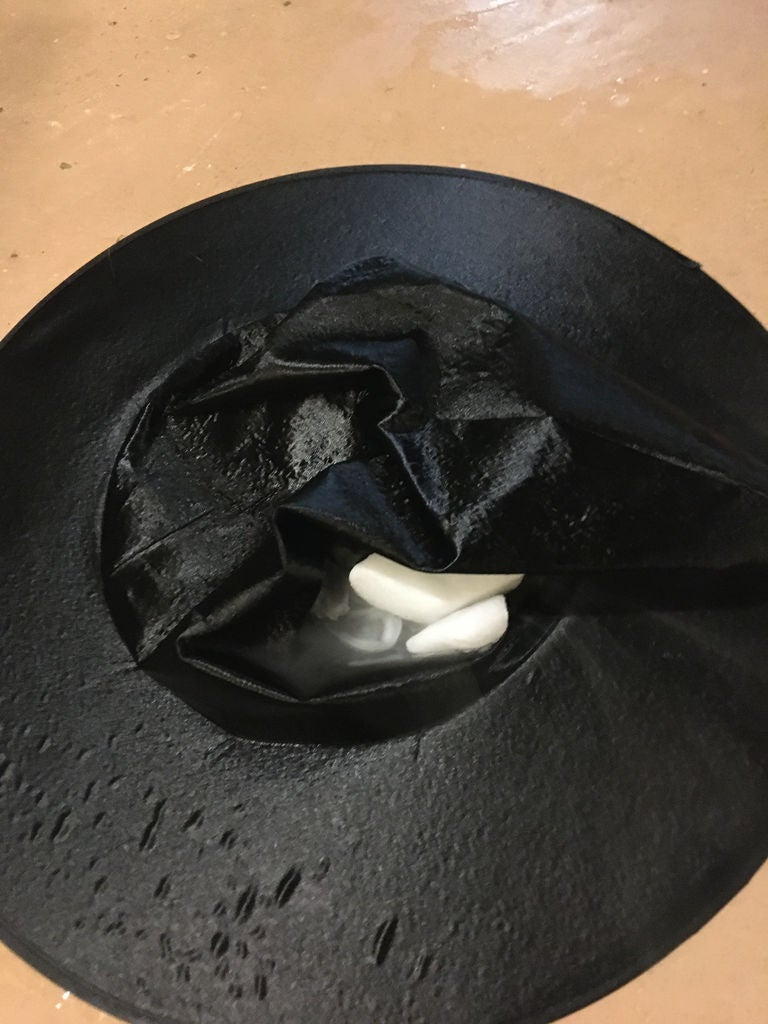 Picture of Place Dry Ice in a Fold on Top of the Witch Hat.