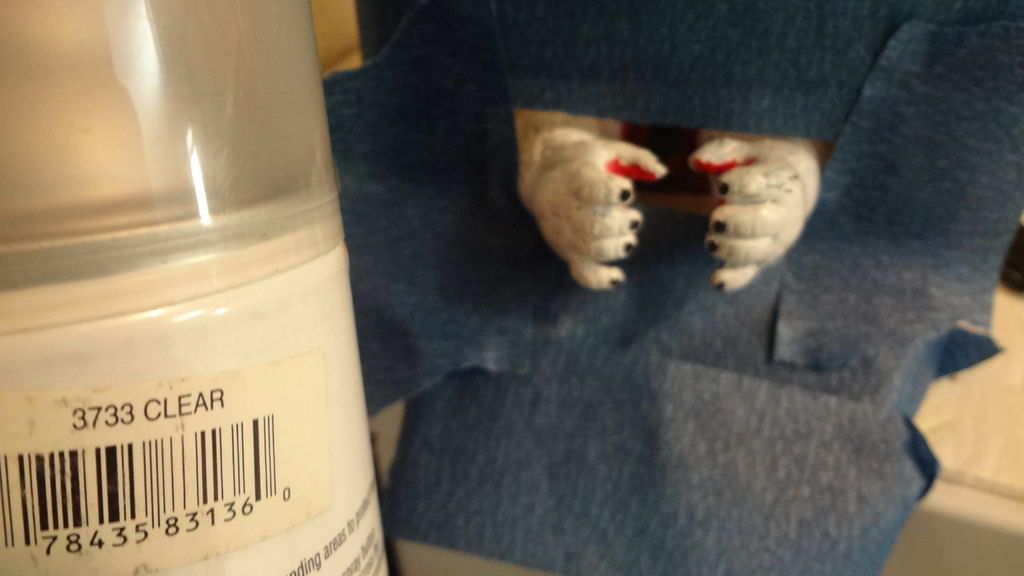 Picture of Painting the Hands and Face & Fastening Candee Into Place.
