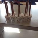 Step #4 Stick Pretzel Rods or Sticks Into Cups